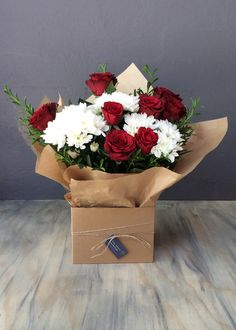 """Nothing says """"I Love You"""" more than this lovely box filled with Red Roses and seasonal flowers and foliage. Say I Love You, Love You More Than, Seasonal Flowers, Simply Beautiful, Red Roses, Valentines Day, Gift Wrapping, Seasons, Box"""