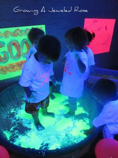 Glow in the dark Mess!    Blacklight themed group sensory play.  This post is loaded with sensory play ideas!