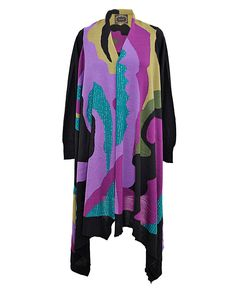 Multi Coloured Intarsia Cape With Sleeves And Sequins Buy from here http://www.rageonline.co.in/1_92_capes-and-ponchos_multi-coloured-intarsia-cape-with-sleeves-and-sequins