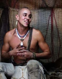 Native Man inside mat-covered house at Plimoth Plantation's Wampanoag Homesite