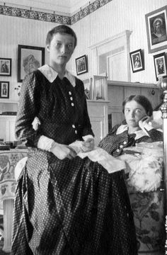 Grand Duchesses Olga(right) and Tatiana(left).  Tatiana's hair has been cut off due to a severe fever, all four grand duchesses had been extremely sick. Circa 1915-1917