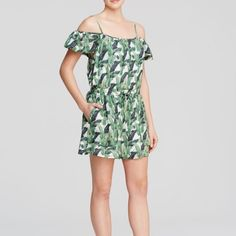 """🌴HP🌴Rebecca Minkoff - Palm Print Romper The super cute on-trend palm print makes this romper so fun! Features flirty, off the shoulder detail and spaghetti straps; elasticized waist, and two front angled pockets. Silk (polyester lined) dry clean. 14"""" rise 3"""" inseam; fit is true to size. Brand new, never worn! Rebecca Minkoff Dresses"""