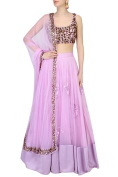 This set features a lavender lehenga in net base with floral thread work motifs scattered all over and a broad lavender silk border along the hem. It has a can-