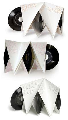 Nice 3 vinyl packaging. Folded paper.