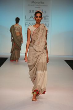 fawn linen sari with jute stems and crimson berries.