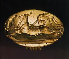 """This Minoan seal depicts the ancient sport of """"bull leaping,"""" which is also seen in a famous Minoan painting of similar nature. This seal captures the importance of the sport to the civilization, as it was important enough to the civilization to be made into a seal."""