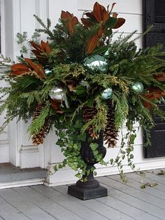 Christmas Urn; like the idea of adding ornaments with the greens.