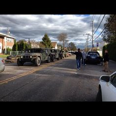 A man waves to the National Guard as they make their way through the streets of New Dorp, #SI.
