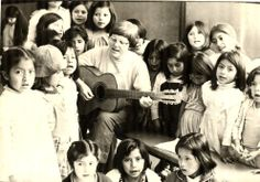 """We are called to live in any part of the world where there is promise of furthering the mission of Jesus through works of education, peace and justice"" (BVM Constitutions, 16). This #ThrowbackThursday, we return to 1981 and Judy Callahan, BVM (Eugene Mary), who sings to children at the Working Boys Center in Quito, Ecuador. BVMs Miguel Conway and Cindy Sullivan minister at the Working Boys Center where BVMs have been for more than 40 years."