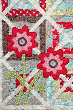 Appliqued Flowers on Quilt