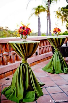 Lime green cocktail table linens pop against the tiled terrace. Wedding Flowers: Kathy Wright & Co Wedding Ceremony Venue: Rancho Valencia Resort Wedding Planner: Details Defined Weddings & Events Wedding Photographer: True Photography