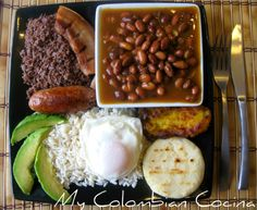 "One of the most typical meals of the Colombian kitchen is the ""Bandeja Paisa"". What's characteristic of this dish is that it includes an enormous amount of proteins and a wide variety of food! Colombian Dishes, Colombian Cuisine, My Colombian Recipes, Healthy Dishes, Food Dishes, Main Dishes, Columbian Recipes, Comida Latina, International Recipes"
