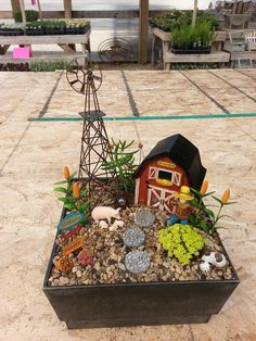 This miniature farm garden is definitely an all time favorite. Love the animals, barn, cornstalks, and the adorable scarecrow! Absolutely perfect.