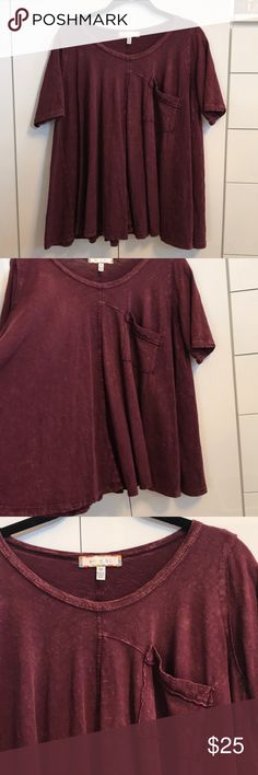 Anthropologie Top Anthropologie Top. This is a fun style especially over skinny jeans, full on bottom. Great preowned condition. Color is wine Anthropologie Tops