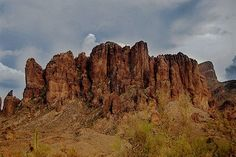 "Parnormal Hot Spot -  Superstition Mountains, Arizona - Among the reported strangeness are: An entry into a subterranean world, Time and dimensional shifts, Spirit faces in the rocks, Location of the famous ""Lost Dutchman"" mine, Site of the Circlestone medicine wheel, 6,000 feet up in the mountains, and During the '50s, '60s and '70s, numerous UFOs were sighted around Flat Iron and Bluff Springs Mountain"