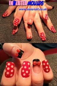 MINNIE MOUSE Inverted Moulds by Cheryl Hammond Nails by Cheryl from Winsford Cheshire UK.  Using our standard French White for the dots and then Backing the design in our new RED nail art powder.  JET BLACK was used for the acrylic tips and then finished off with a red 3D acrylic bow attached using L on the outside of the