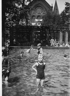 The wading pool at Washington Park with Music Hall in the background 1936