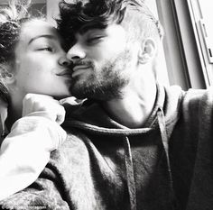 Celebrating love! Gigi Hadid displayed her devotion to boyfriend Zayn Malik on Valentine's Day by posting a cute black and white photo of the two sharing a tender moment together