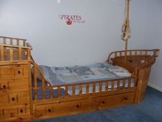 A pirate boat bed.....tons of storage and lots of fun!