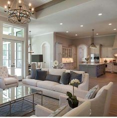 We absolutely love this set up for the living room (sofas, chairs, colors, chandaleer). Like a wood table better, but really like this a lot!
