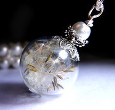 A personal favorite from my Etsy shop https://www.etsy.com/listing/188571573/dandelion-necklace-silver-make-a-wish