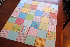 Sewing a baby quilt....only 2 layers....tied on corners with embroidery floss