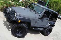 """2003 Flat Gray Wrangler - $14,995 - Just 75k Miles, 5-Speed Manual Transmission, 4"""" Rancho Suspension Lift, 33"""" Interco M16 Tires, Bestop Side Steps, Custom Front and Rear Bumpers, Hard Top, etc.... http://www.selectjeeps.com/inventory/view/8465240/2003-Jeep-Wrangler-2dr-X-League-City-TX"""
