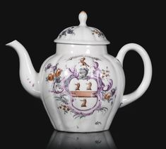 AN IMPORTANT WEST PANS ARMORIAL TEAPOT AND COVER, CIRCA 1770 the fluted ovoid body painted on each side with the unauthorised arms of Tod, or Todd, of Scotland, argent, a fess gules between three foxes heads, couped, the crest a fox rampant, within a puce leaf and scroll rococo cartouche with trailing flower sprays, beneath the motto OPORTET VIVERE on a ribbon band, damaged and repaired.