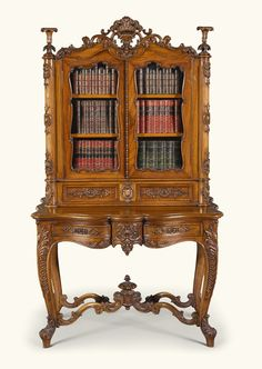A Scottish early Victorian carved walnut display cabinet-on-stand, mid-19th century, attributed to John Taylor & Sons of Edinburgh