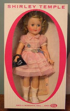 I love the Shirley Temple Doll.  I have a blue dress just like this that my parents had my picture taken in when I was a baby.  I plan to take a picture of my granddaughter in the dress when she is big enough to wear it.  I never new it was a Shirley Temple dress.  Cool!