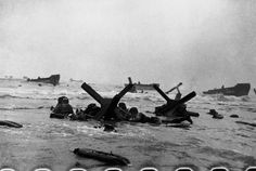 Robert Capa June 6th, 1944 Normandy. Omaha Beach The first wave of American troops lands at dawn