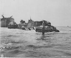 Tanks of 'C' Company, 191st Tank Battalion unloading across a pontoon causeway near Salerno, Italy, 9 September 1943.