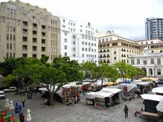 """We stayed in a """"serivce apartment"""" on Green Market Square. More than a hundred vendors would come in every day and set up their stands then break them down again at the end of the day. Heart Place, Cape Town South Africa, Morocco, Places Ive Been, Photographs, Street View, Marketing, History, Architecture"""