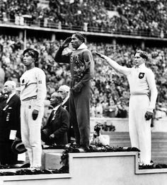 American Jesse Owens on the podium after winning the long jump at the 1936 Summer Olympics.