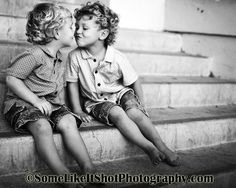 twin 2 year old boys kissing with curly hair. Child photography in Seattle Tacoma WA www.SomeLikeItShotPhotography.com