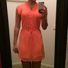 H&M Peach Dress! It's a size 2! I'm 5'5 and the dress sits a few inches above my kneee! The color is a peach/ orange color. Perfect for special occasions such as graduation. H&M Dresses