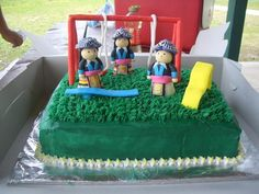 This cake was made for a niece of mine. The dolls and playground are made of fondant. The dolls represent Hmong girls.