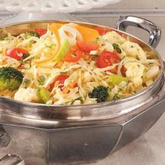 Low-Fat Vegetable Slaw Recipe -This pretty combination of fresh veggies is low fat and to enhance the flavors, it can be made at least an hour before serving. For extra color, half-cup portions of squash and red and green pepper can be added.