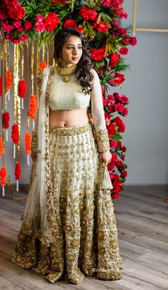 A Mint Green Lehenga with heavy Gold embellishment and a net dupatta by Kalki fashion for Real Bride Khusboo Bhatia at WeddingSutra on Location.