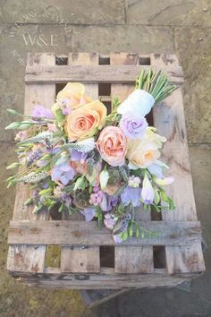 We used Roses, Freesias, Lisianthus, Snowberries & Mint to create this beautiful Bouquet for a Peach & Lilac inspired Wedding www.weddingandevents.co.uk