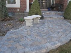 Patio Pavers for a front porch with paver steps       Concrete pavers for front porch.     Paver steps and walkway also installed on this project as well as concrete bench.   Hardscapes installed by Creative Hardscape Company, Inc.   Denver Metro Area, Colorado