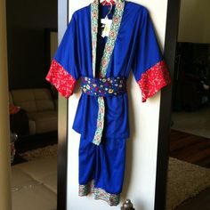 Beautiful OBI Wrap Pajama Set-Perfect Gift Just gorgeous! Asian Wrap style pajama top with contrasting sequined lapel and red contrasting fluted sleeves. An intricately embroidered OBI completes the look. So beautiful I believe it can be worn out. Care packet with extra sequins. Cabernet Other