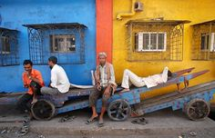 Laborers rest on a hand-cart in an industrial area in Mumbai, Maharashtra, on International Labor Day.