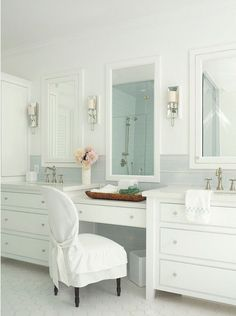 "Latest Coastal Living ShowhouseClassic elements are found in the master bathroom.  Cabinet paint color is ""Pratt & Lambert Designer White""."
