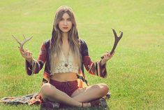 Bare midriff, croceted halter top, bell sleeves on multi-toned long sweater, platform suede shoes, turquoise ring, flowy hair
