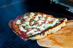 The best way to make pizza at home, grill it! Step-by-step instructions for how to grill pizza. Wonderful smokey flavor without smoking up your house. #pizza #grill