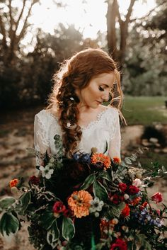 This bridal beauty look features refined, natural makeup, a romantic braid with seed pearls and a gorgeous long-sleeve lace wedding dress | image by Kerlyn Van Gelder