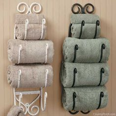 Powder room redo in Tuscan-theme. This wrought iron wine rack solves the problem of having little towel storage.