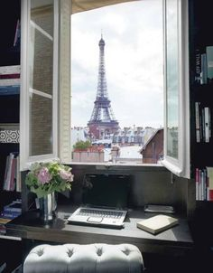 I want a work space like this, in front of a window with a great view and fresh flowers.  Reminds me of Carrie Bradshaw's workspace.