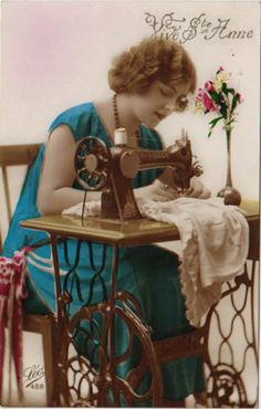 1920's Woman sewing on her fancy treadle machine.  This is part of being a vintage housewife.